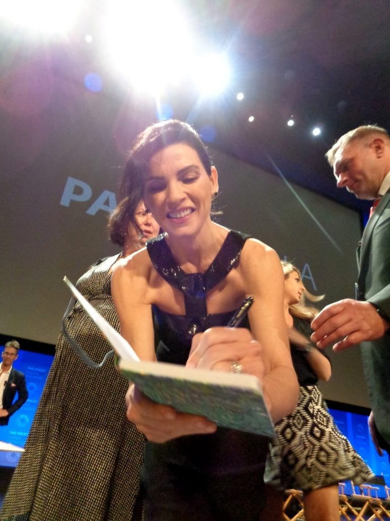 Juliana Marguiles signing my notebook