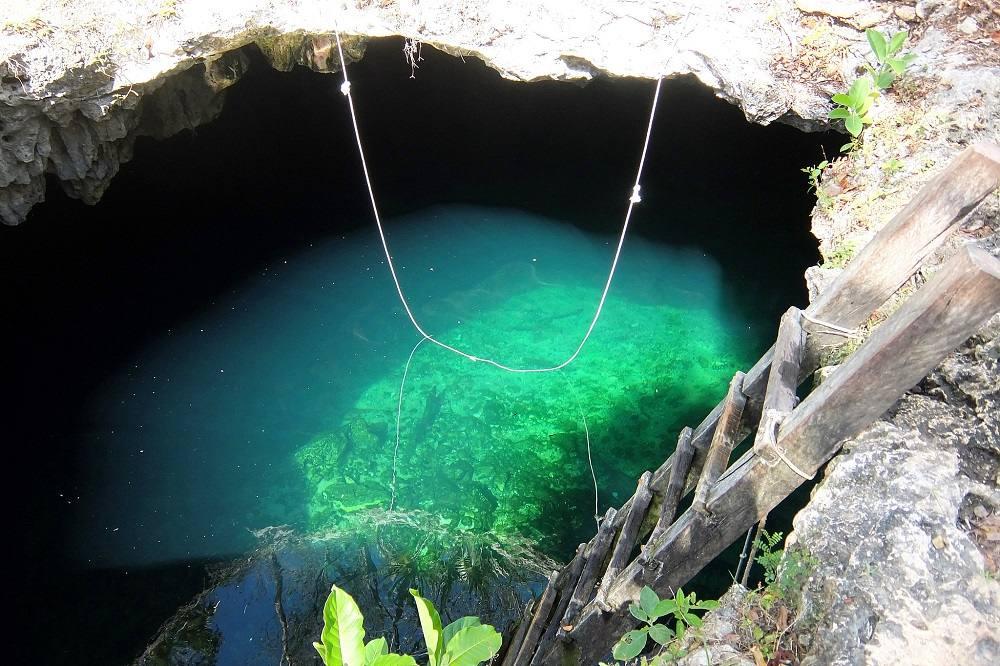 cenote-calavera-tulum-mismatched-passports